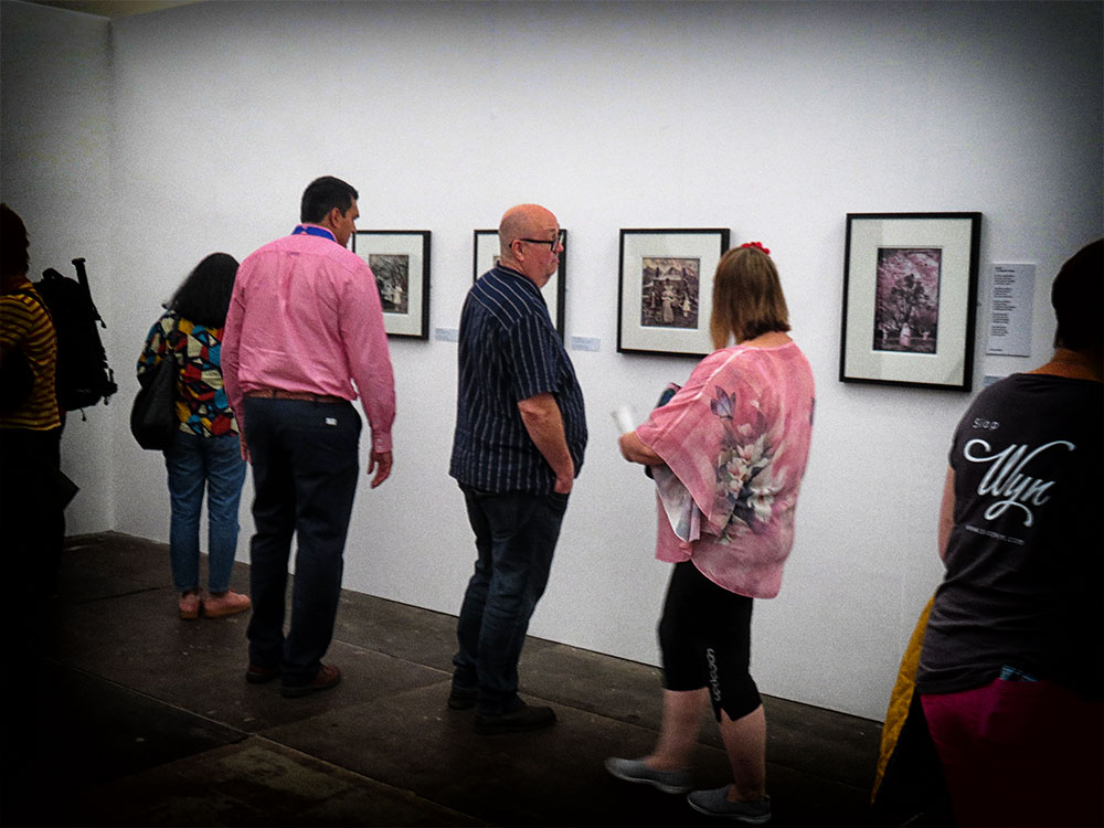 People viewing the work at Y Lle Celf 2019